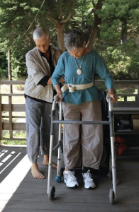 "Grace Dammann gets rehabilitation help from her partner, Nancy ""Fu"" Schroeder."
