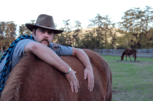 Phil Straub embraces Elvis at the Morgan Horse Ranch. Photo by Molly Oleson.
