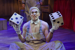 Eddie Lopez, offering up a game of chance, plays Koko in A.C.T.'s production of 'The Unfortunates' at the Strand Theater. Photo by Kevin Berne.