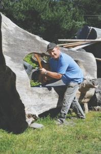Chuck Oakander, a Bolinas-based arborist-sculptor, makes fun, functional pieces from tree trunks. Staff photo.