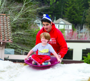 Kids get to go snow sledding at the Mill Valley Winterfest on December 4 at the Downtown Plaza in Mill Valley. Photo by Kirke Wrench.