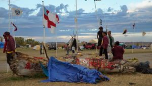 For several months, indigenous people, environmentalists and Great Plains residents have protested the Dakota Access Pipeline. This photo is a production still from the upcoming documentary 'Layin' the Pipe' by Caitlin Kazepis. Photo by Caitlin Kazepis.