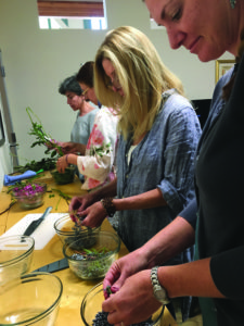 Women at Gathering Thyme prepare medicine made from nature. Photo courtesy of Gathering Thyme.